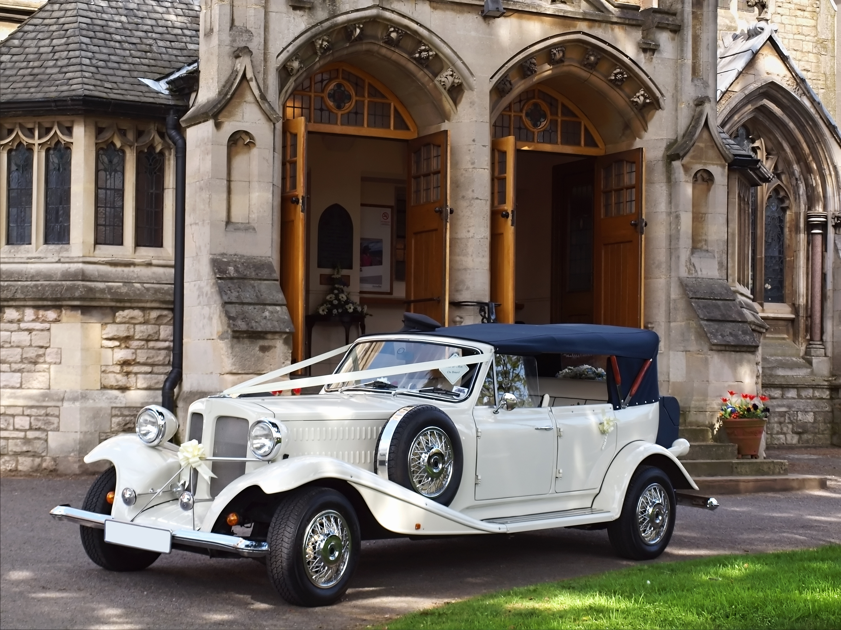 Wedding car in front of church waiting for bride and groom ** Note: Slight blurriness, best at smaller sizes
